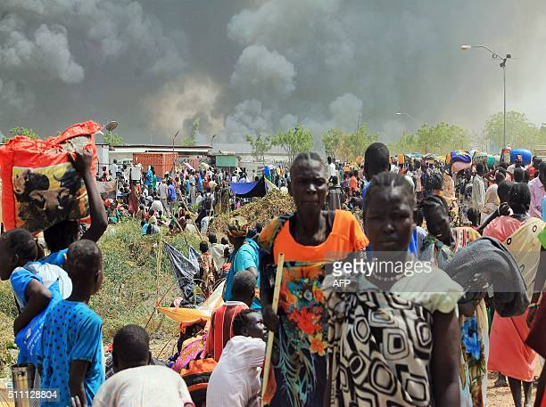 South Sudanese civilians flee fightings in the northeastern town of Malakal on February 18 where gunmen opened fire on civilians sheltering inside a...