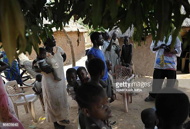 A south Sudanese family gathered under a tree is instructed on how to protect themselves from malaria on April 3 2009 at Wau 513 km from Juba an area...
