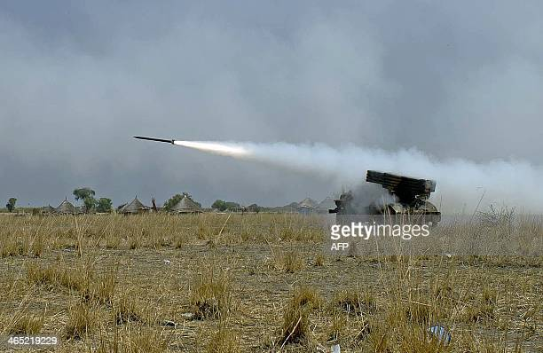 South Sudanese government soldiers fire a rocket toward a rebel position in Bor on January 26 2014 during an exchange of heavy artillery fire South...