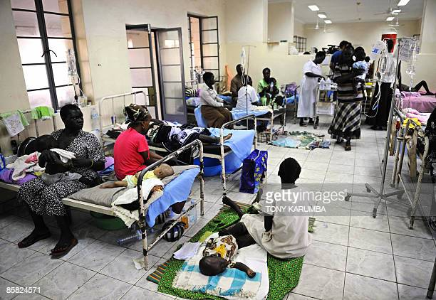 South Sudanese infants and their mothers are cared for on April 2 2009 in a malaria ward at the main hospital in Juba where the population is exposed...