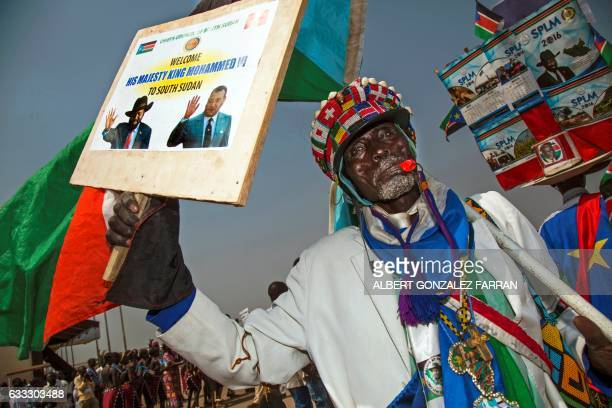 A South Sudanese man dances during a welcoming ceremony for The King of Morocco on February 1 at Juba airport at the start of his two day visit to...