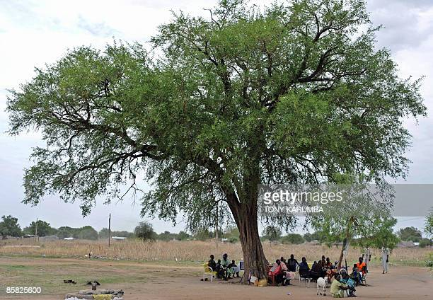 South Sudanese parents and their children attend an openair clinic on April 2 at Terekeka 82 km north of Juba an area where the population is exposed...