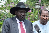 South Sudanese President Salva Kiir flanked by African Union special envoy and former Malian President Alpha Oumar Konare talks to the media on July...