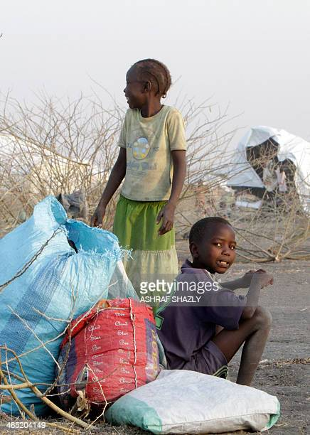 A South Sudanese refugee child looks at the photographer at a camp run by Sudanese Red Crescent where he arrived with his family after fleeing...