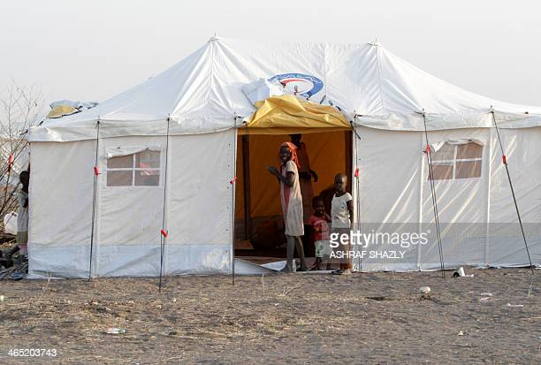 South Sudanese refugee children pose at the entrance of a tent at a camp run by Sudanese Red Crescent where they arrived after fleeing battles...