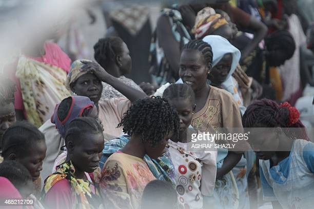 South Sudanese refugees gather at a camp run by the Sudanese Red Crescent on January 26 2014 in the western part of Sudan's White Nile state about 30...