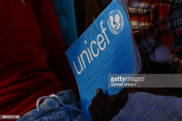 South Sudanese refugees take reading lessons at the UNHCR camp of alAlgaya in Sudan's White Nile state south of Khartoum on May 17 2017 More than...