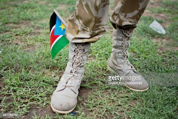 A South Sudanese soldier stands with a South Sudan flag in his boot during a parade to celebrate the 31st anniversary of the Sudan People...