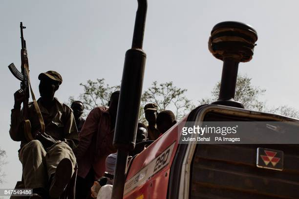 South Sudanese soldiers on a tractor near Doro refugee camp in BunjMaban in the Upper Nile Blue Nile state of northeastern South Sudan AfricaThe...