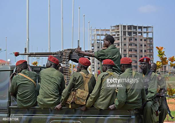 South Sudanese soldiers secure a road near Juba's airport on August 26 2014 South Sudan's warring leaders signed a fresh ceasefire deal on August 25...