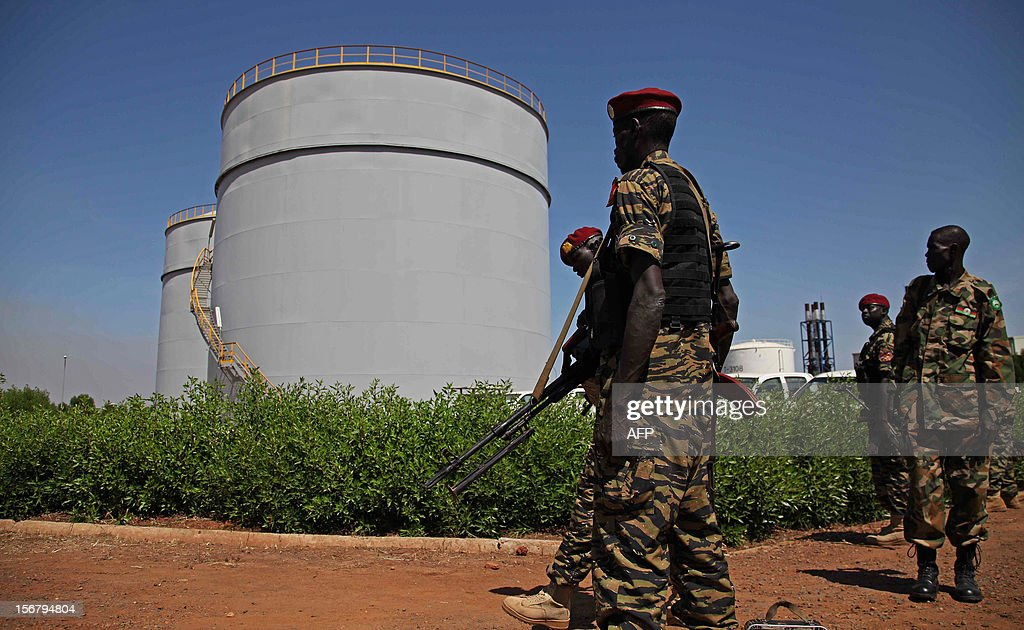 South Sudanese soldiers stand during President Salva Kiir's visit to an oil refinery in Melut, Upper Nile State, South Sudan on November 20, 2012. In January 2012, South Sudan cut off oil production for 10 months after accusing Sudan of stealing its crude. The shut down escalated into border conflict in April 2012, but the two sides later signed deals to restart the oil. Kiir claims the restarting of oil production has been delayed due to further demands made by Sudan after the agreement was reached.