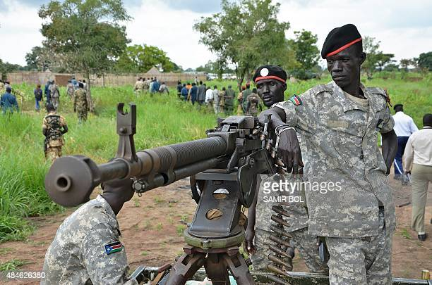 South Sudanese SPLA soldiers are pictured in Pageri in Eastern Equatoria state on August 20 2015 The spokesman of SPLA Colonel Philip Aguer visited...