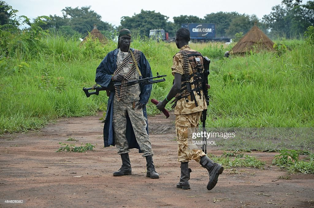 South Sudanese SPLA soldiers are pictured in Pageri in Eastern Equatoria state on August 20, 2015. The spokesman of SPLA, Colonel Philip Aguer visited the area after the government claimed to be back in control of the area following an attack by rebel forces. South Sudan's civil war began in December 2013 when Kiir accused his former deputy Riek Machar of plotting a coup, setting off a cycle of retaliatory killings that has split the poverty-stricken country along ethnic lines. The government says they will return to talks in Ethiopia in early September to 'finalise' a peace deal.