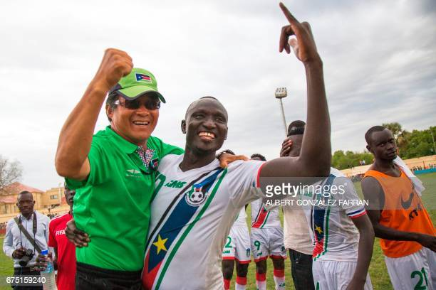 South Sudan's coach Hung Se Lim celebrates with South Sudan's captain James Joseph Moga after defeating Somalia during the first round African...