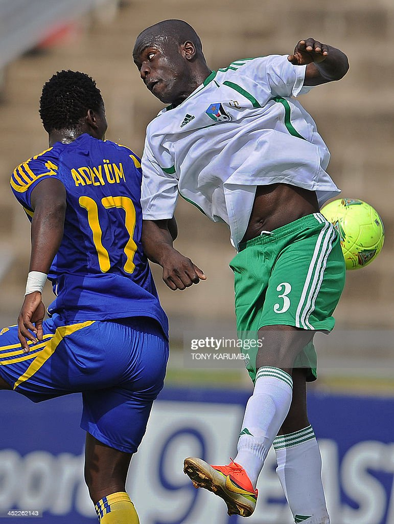 South Sudan's Edomon Amadeo (R) fights for the ball with Zanzibar's Ahmed Adeyum during the Council for East and Central Africa Football Associations (CECAFA) Cup football tournament match between South Sudan and Zanzibar in Nairobi, on November 27, 2013. AFP PHOTO/Tony KARUMBA