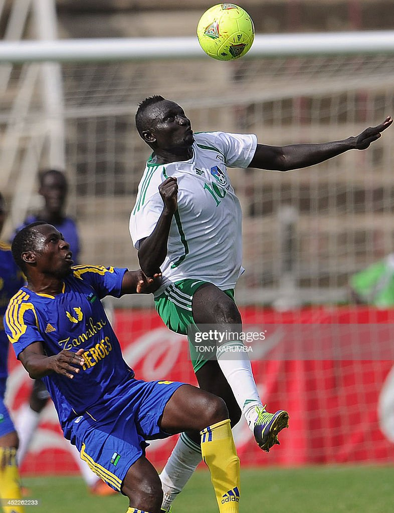 South Sudan's James Joseph (R) fights for the ball with Zanzibar's Omar Wazirsalum during the Council for East and Central Africa Football Associations (CECAFA) Cup football tournament match between South Sudan and Zanzibar in Nairobi, on November 27, 2013. AFP PHOTO/Tony KARUMBA