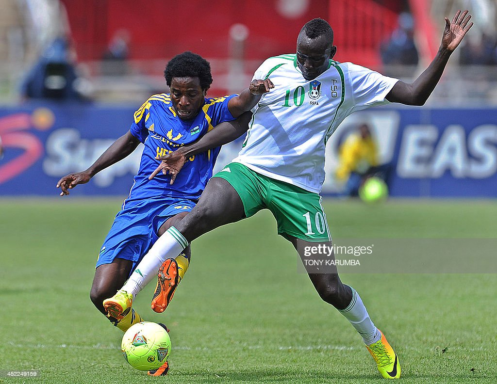 South Sudan's James Joseph (R) fights for the ball with Zanzibar's Sabri Ali Makame during their opening match of the Council for East and Central Africa Football Associations (CECAFA) Cup football tournament in Nairobi, Kenya, on November 27, 2013. AFP PHOTO/Tony KARUMBA