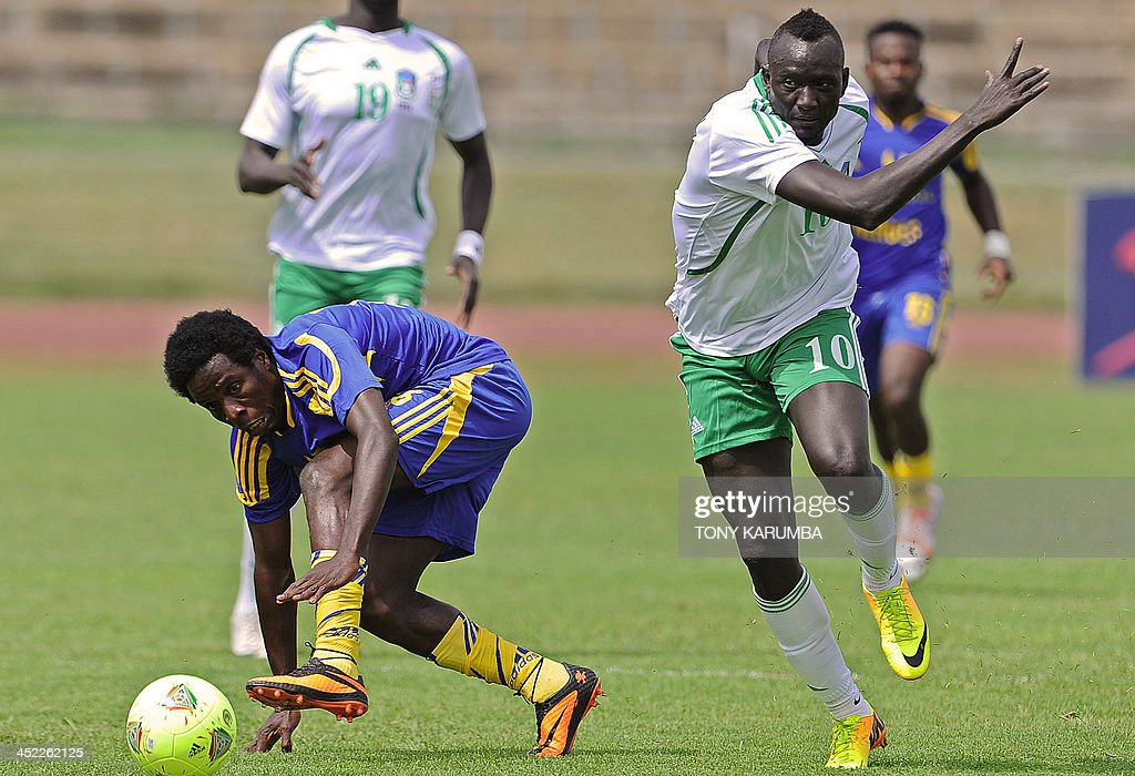 South Sudan's James Joseph (R) fights for the ball with Zanzibar's Sabri Ali Makhame during the Council for East and Central Africa Football Associations (CECAFA) Cup football tournament match between South Sudan and Zanzibar in Nairobi, on November 27, 2013. AFP PHOTO/Tony KARUMBA
