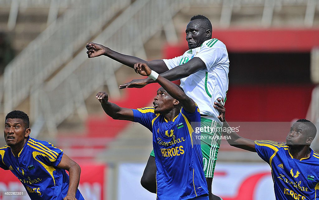 South Sudan's James Joseph (C) jumps above Zanzibar's Mohamed Faki Khatib (L), Shafi Hassan Rajab (2nd L) and Salum Hamis Bakari during the Council for East and Central Africa Football Associations (CECAFA) Cup football tournament match between South Sudan and Zanzibar in Nairobi, on November 27, 2013.