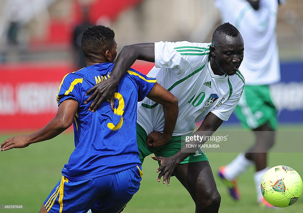 South Sudan's James Joseph (R) vies with Zanzibar's Mohamed FakiKhatib during the football match Zanzibar vs Republic of South Sudan as part of the Council for East and Central Africa Football Associations (CECAFA) cup in Nairobi, on November 27, 2013. AFP PHOTO/Tony KARUMBA