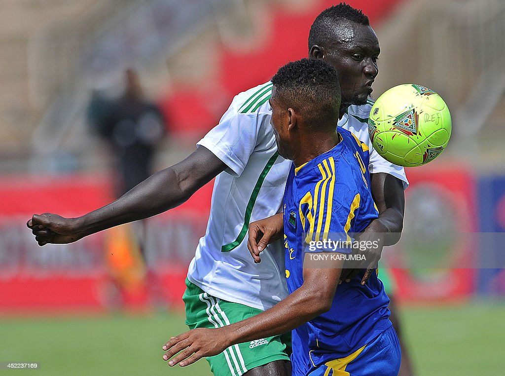 South Sudan's James Joseph (R) vies with Zanzibar's Mohamed FakiKhatib during the Zanzibar vs Republic of South Sudan football match as part of the Council for East and Central Africa Football Associations (CECAFA) cup in Nairobi, on November 27, 2013. AFP PHOTO/Tony KARUMBA