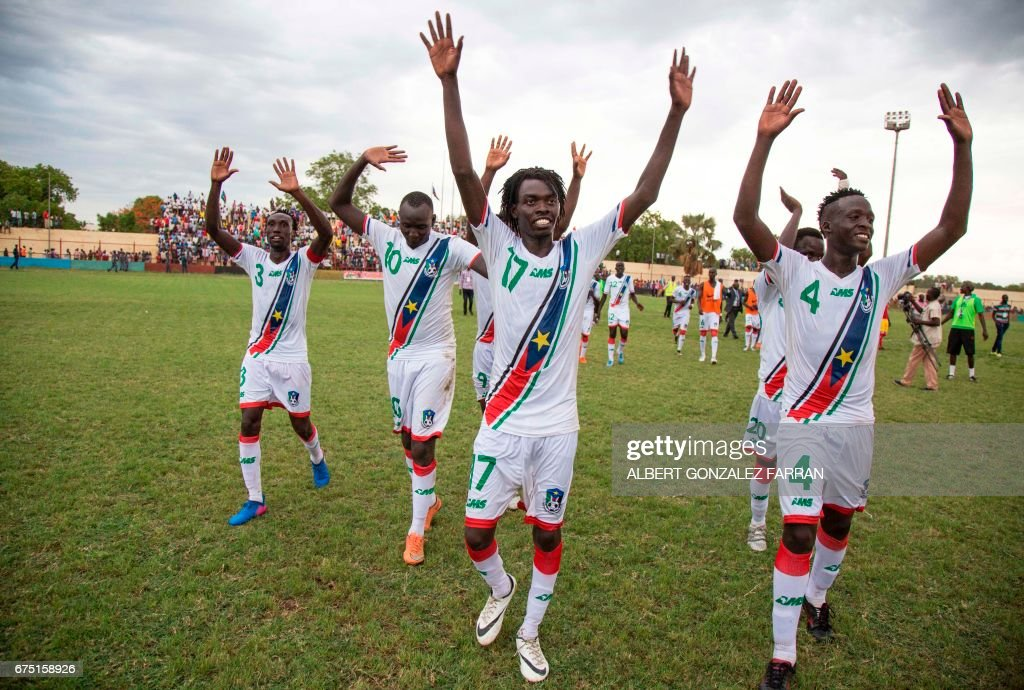 South Sudan's players celebrate after defeating Somalia during the first round African Nations Championship qualifying football match at Juba Football Stadium on April 30, 2017. / AFP PHOTO / Albert Gonzalez Farran