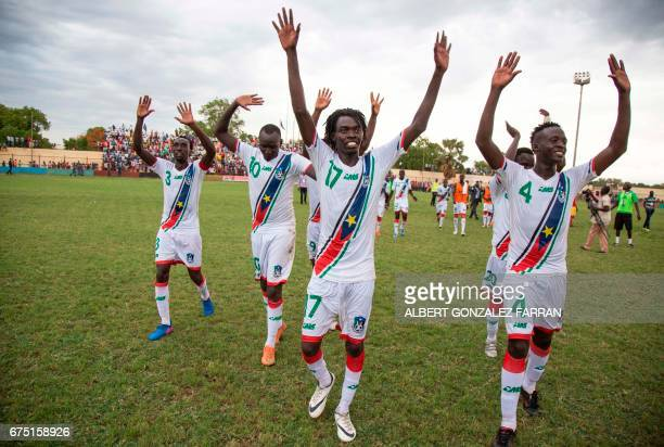 South Sudan's players celebrate after defeating Somalia during the first round African Nations Championship qualifying football match at Juba...