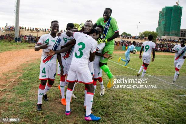 South Sudan's players embrace their captain James Joseph Moga after he scored the second goal during the first round African Nations Championship...