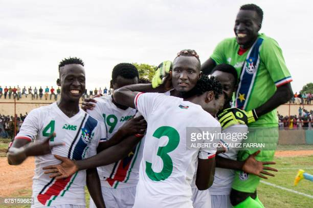 TOPSHOT South Sudan's players embrace their captain James Joseph Moga after he scored the second goal during the first round African Nations...