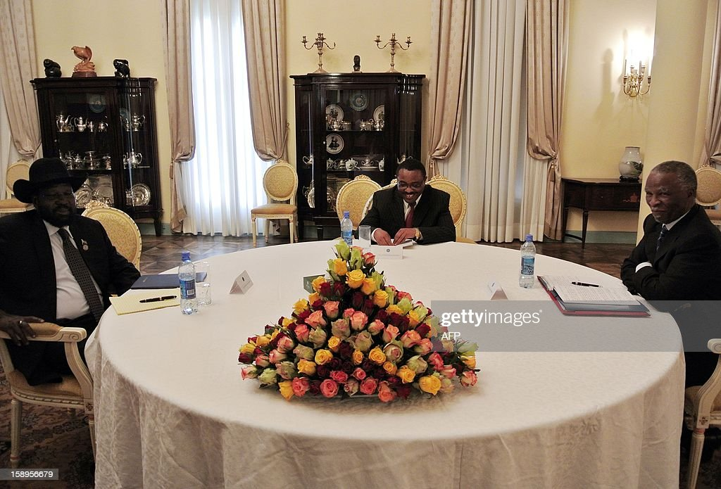 South Sudan's President Salva Kiir (L), Ethiopian Prime Minister Hailemariam Desalegn (C) and Thabo Mbeki (R), the chief mediator for talks between South Sudan and former civil foe Sudan, meet in Addis Ababa on January 4, 2013. Kiir is in the Ethiopian capital on Hailemariam's invitation to meet with his Sudanese counterpart, Omar al Bashir, to push for progress on stalled oil, border and security talks. The two former civil war foes signed a raft of agreements in September, but none have yet been implemented, with the South accusing Khartoum of fresh attacks this week. Negotiations between the two rivals have been ongoing since Juba split from the North in July 2012, and though a series of deals have been forged, none have been successfully put in place.