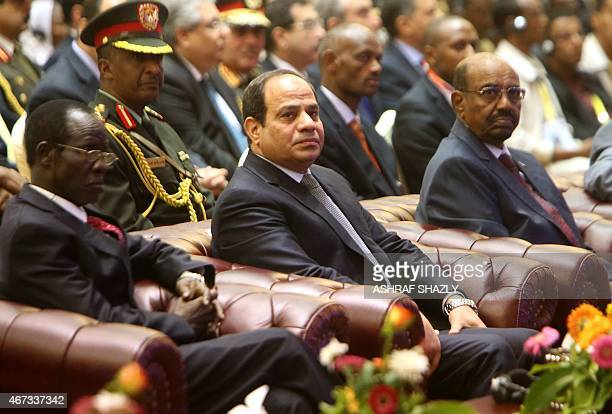 South Sudan's Vice President James Wani Igga Egyptian President AbdelFattah alSisi and Sudanese President Omar alBashir attend a meeting in the...