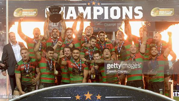 South Sydney Rabbitohs celebrate with the trophy after victory in the World Club Challenge match between St Helens and South Sydney Rabbitohs at...