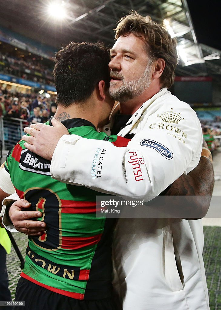 South Sydney Rabbitohs part owner Russell Crowe (R) embraces Issac Luke (L) of the Rabbitohs after the First Preliminary Final match between the South Sydney Rabbitohs and the Sydney Roosters at ANZ Stadium on September 26, 2014 in Sydney, Australia.