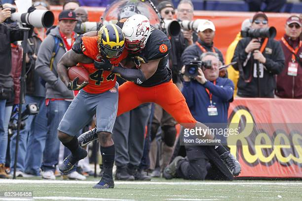South Team Tyus Bowser tackles North Team De'Veon Smith during the 2017 Senior Bowl college football game at LaddPeebles Stadium Mobile AL