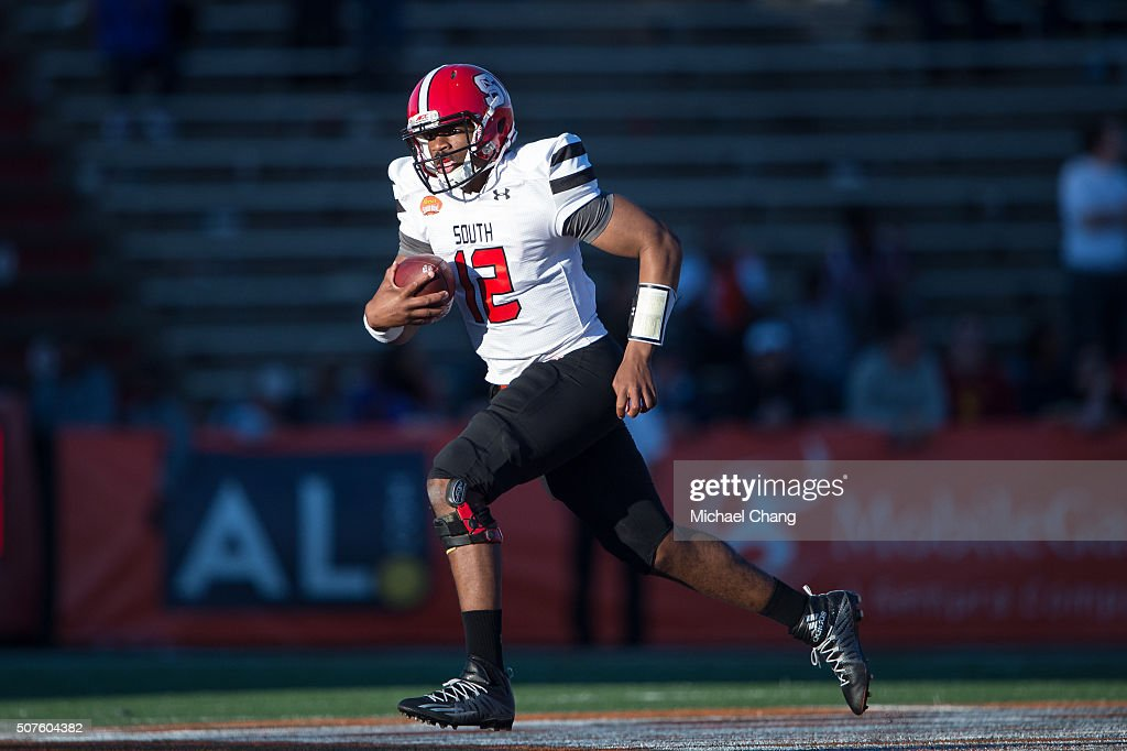 South team's quarterback Jacoby Brissett #12 with North Carolina State runs the ball downfield during their game against the North Team on January 30, 2016 at Ladd-Peebles Stadium in Mobile, Alabama.