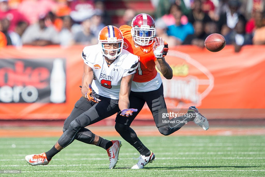 South team's wide receiver Charone Peake #9 with Clemson looks to catch a pass in front of North team's defensive back Tavon Young #21 with Temple on January 30, 2016 at Ladd-Peebles Stadium in Mobile, Alabama.