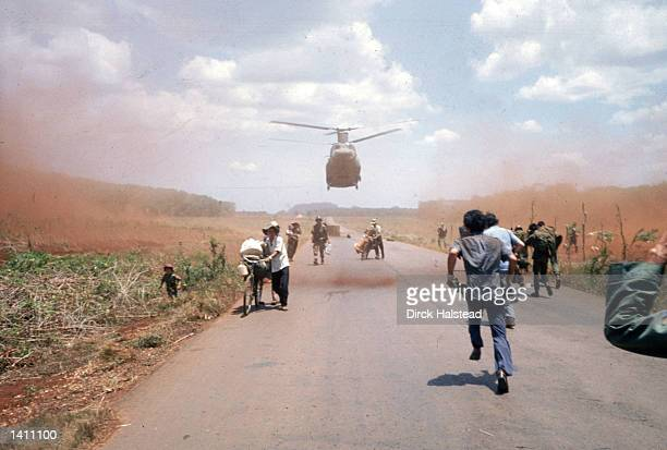South Vietnamese flee Saigon April 1975 with the help of the US military American involvement in the Vietnam War came to an end when troops from...