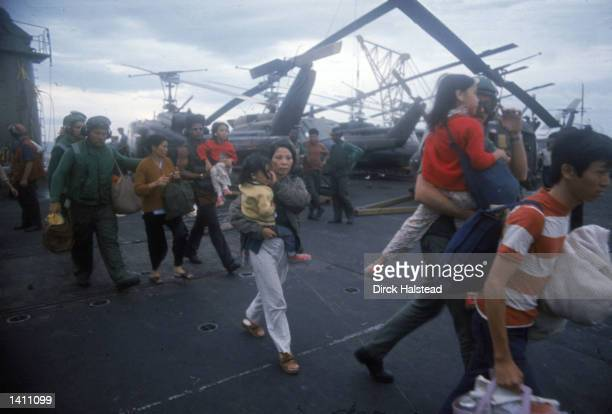 South Vietnamese refugees board a US war ship April 1975 in the South China Sea near Saigon American involvement in the Vietnam War came to an end...