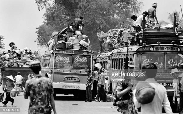South Vietnamese residents of Nha Trang pack their belongings on buses as they get ready to flee the advancing North Vietnamese troops who are...