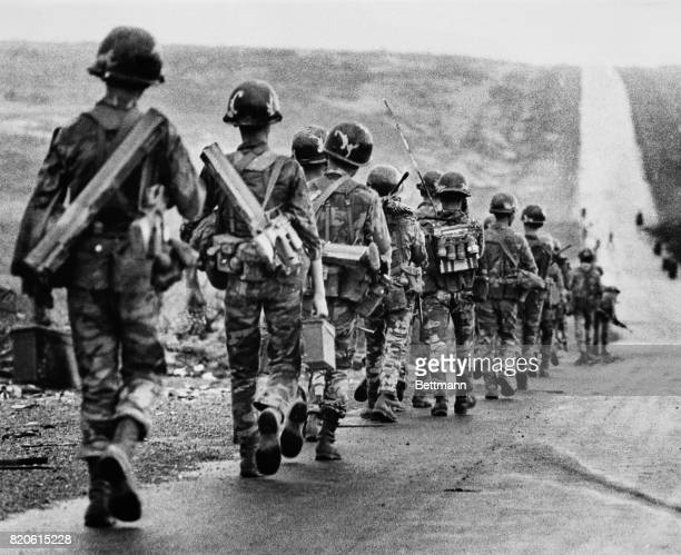 South Vietnamese troops march down Highway 13 toward An Lc to relieve their fellow soldiers who are surrounded by North Vietnamese regulars 1972