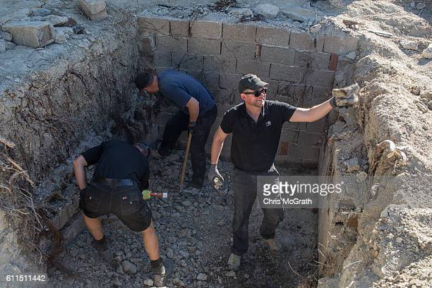 South Yorkshire Police work to excavate a sceptic tank in search of missing toddler Ben Needham on September 30 2016 in Kos Greece The 21 month old...