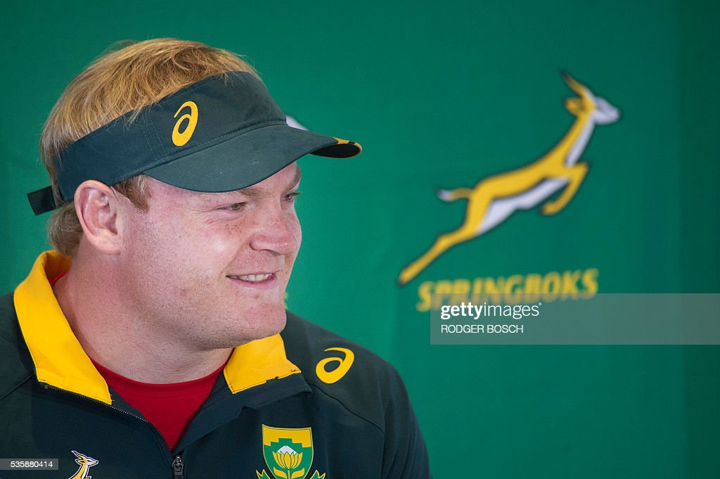 South-African lock Adriaan Strauss (R) gives a press conference as the Springbok's 57th captain, after a training session in Stellenbosch, on May 30, 2016. Springbok coach Coetzee announces on May 30 that the South African lock Adriaan Strauss will be the Springbok's 57th captain. / AFP / RODGER