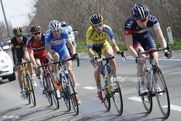 SouthAfrica's Jaco Venter of MTNQhubeka Team Danemark's Sebastian Lander of BMC Racing Team Belgium's Frederik Veuchelen of WantyGroupe Gobert Team...