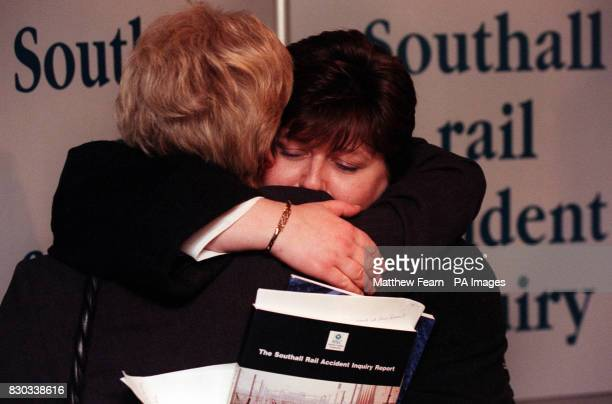 Southall rail crash survivor Carol Bell hugs Joan Petch wife of victim Tony Petch at a news conference in London where the long delayed official...