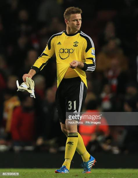 Southampton Artur Boruc shows his dejection after the goalkeeper's mistake lead to Arsenal's Olivier Giroud scoring the opening goal in the Barclays...