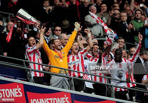 Southampton captain Dean Hammond and goalkeeper Kelvin Davis lift the trophy after winning the Johnstone's Paint Trophy Final between Southampton and...