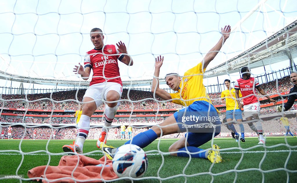 Southampton defender Jos Hooiveld fails to clear defender Kieran Gibb's shot for the 1st Arsenal goal during the Barclays Premier League match between Arsenal and Southampton at Emirates Stadium on September 15, 2012 in London, England.