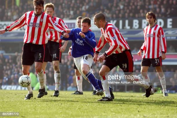 Southampton defenders lr Claus Lundekvam Michael Svensson Danny Higginbotham and Jo Tessem try and contain Everton's Wayne Rooney