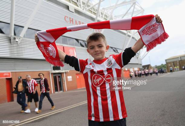 Southampton fan poses for a photograph while holding a scarf prior to the Premier League match between Southampton and West Ham United at St Mary's...