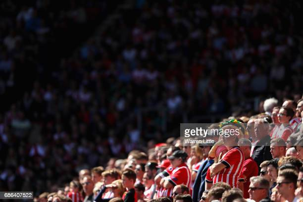 Southampton fans look on during the Premier League match between Southampton and Stoke City at St Mary's Stadium on May 21 2017 in Southampton England